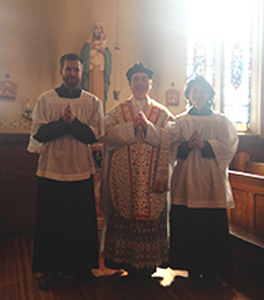 Servers and celebrant in the church